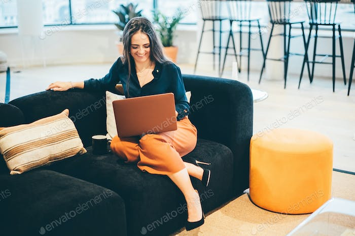 Businesswoman working in modern co-working.