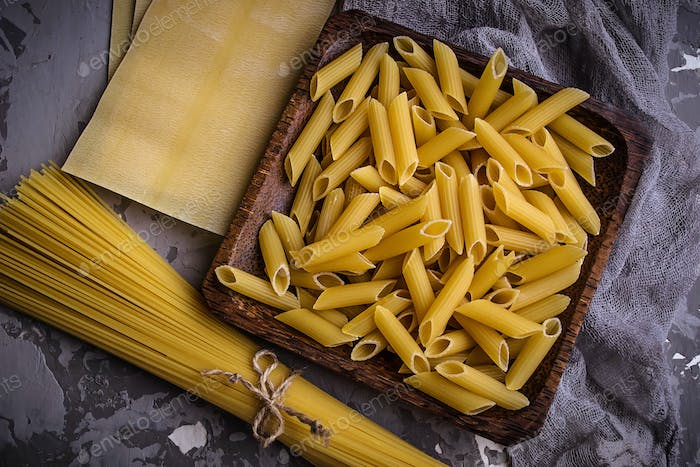 Different kinds of pasta: penne, spaghetti, lasagna