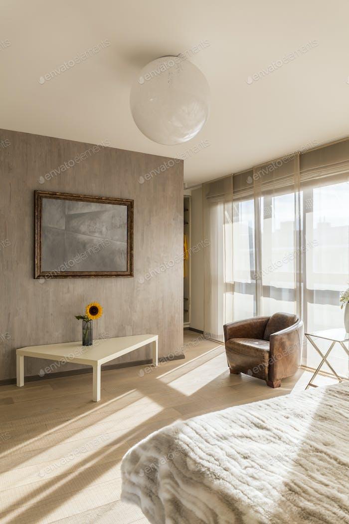 Elegant bedroom with armchair