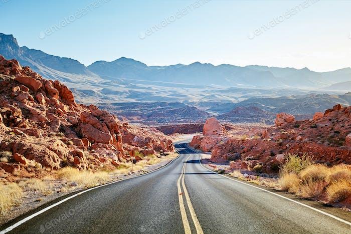 Scenic desert road at sunset.