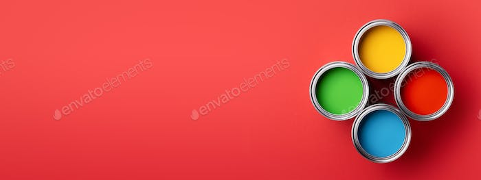 Four Cans of Colorful Paint on Red Background. Banner.