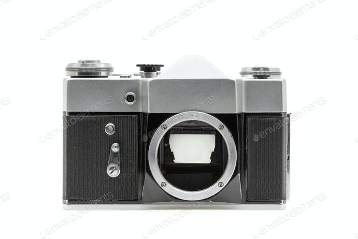 Old film retro camera without lens isolated on white background