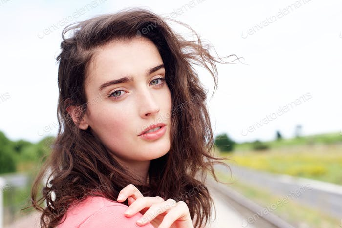 Close up attractive young woman staring