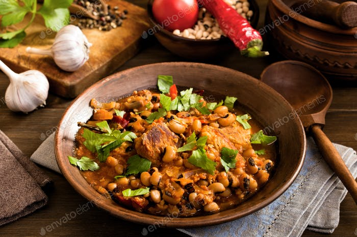 Baked beans with pork and spoon