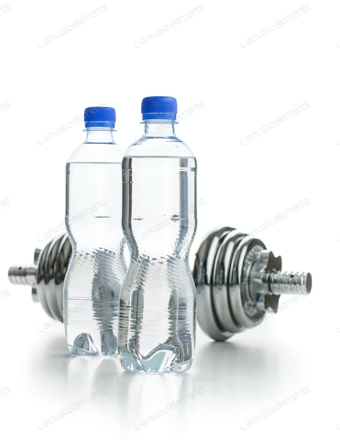 Bottle water and dumbbell.