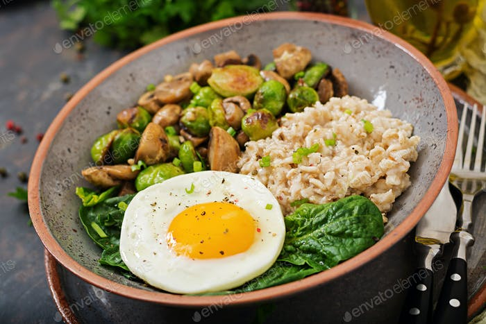 Oat porridge, egg and salad of baked vegetables - mushrooms and Brussels sprouts