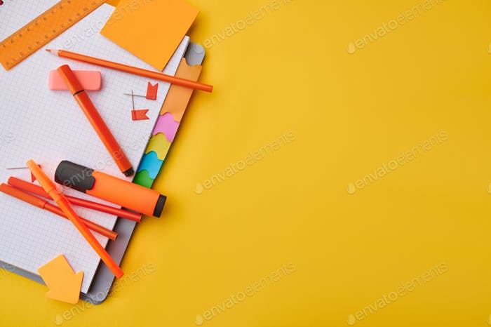 Office stationery supplies on opened notepad