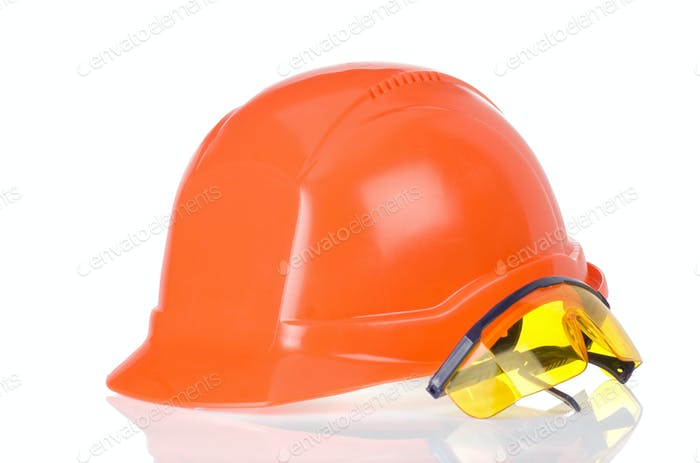 construction helmet and glass tool on white