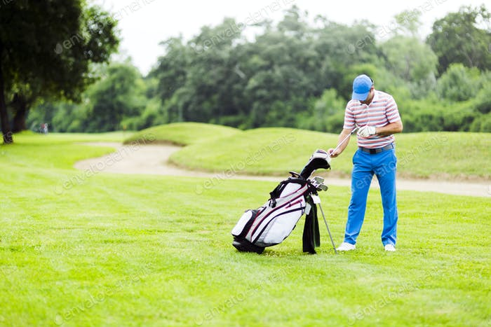 Golfer selecting appropriate club