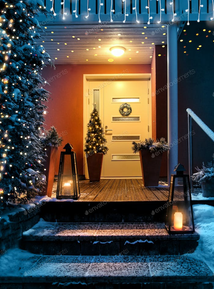 Welcome Christmas house entrance door in Xmas evening