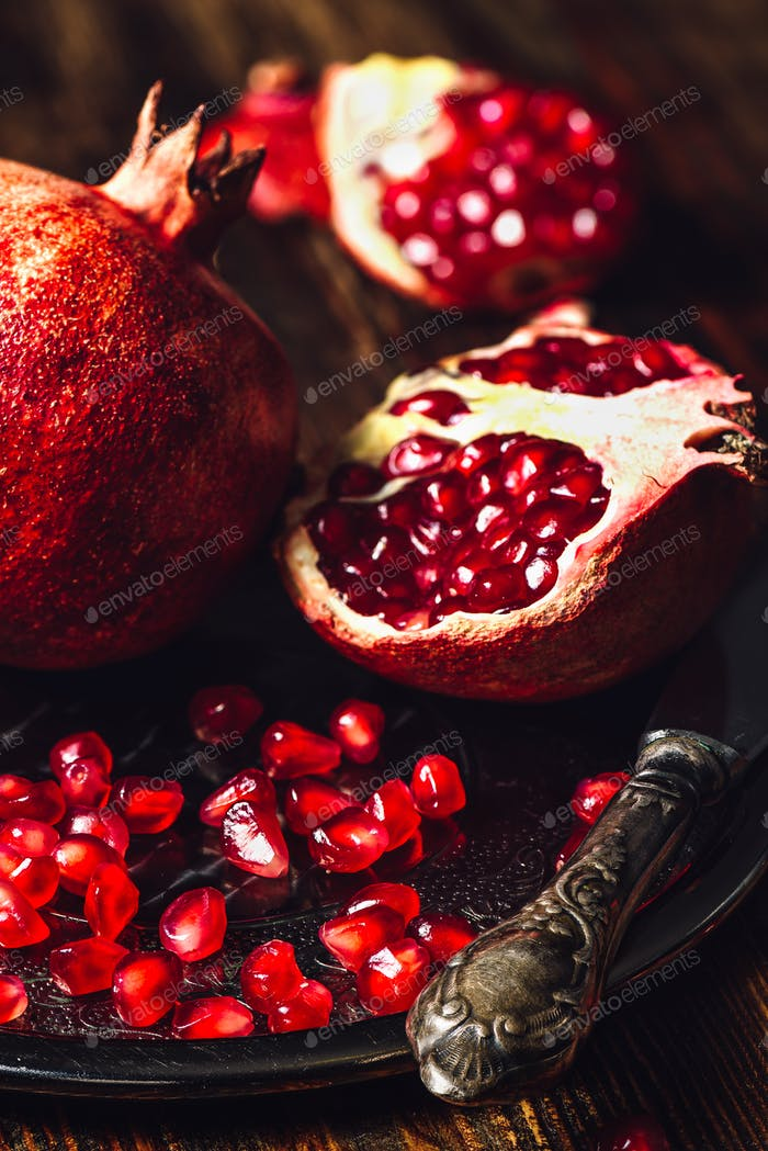 Ruby Pomegranate with Seeds and Knife
