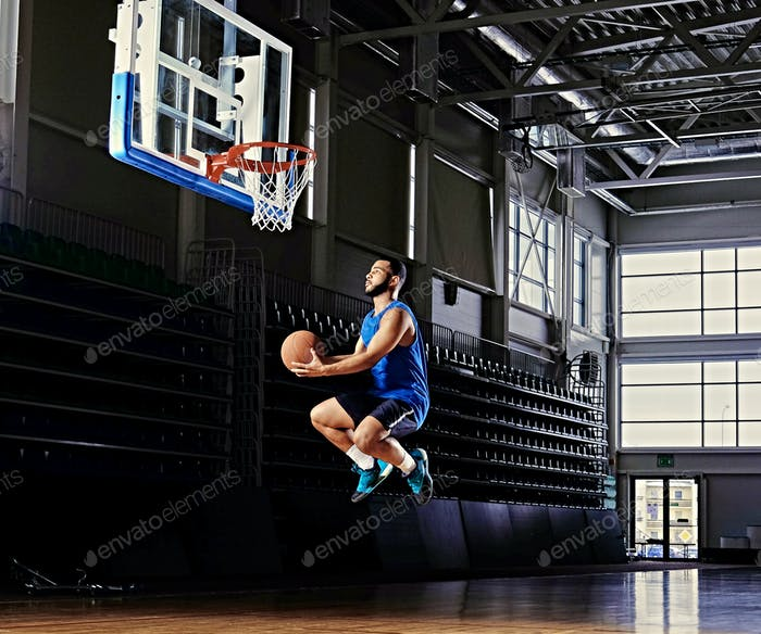 Professional basketball player in action on a basketball field.