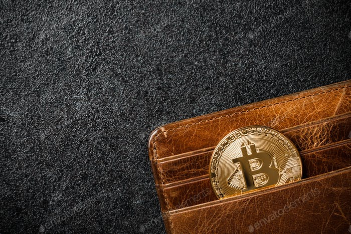 Bitcoin coin in wallet on black background