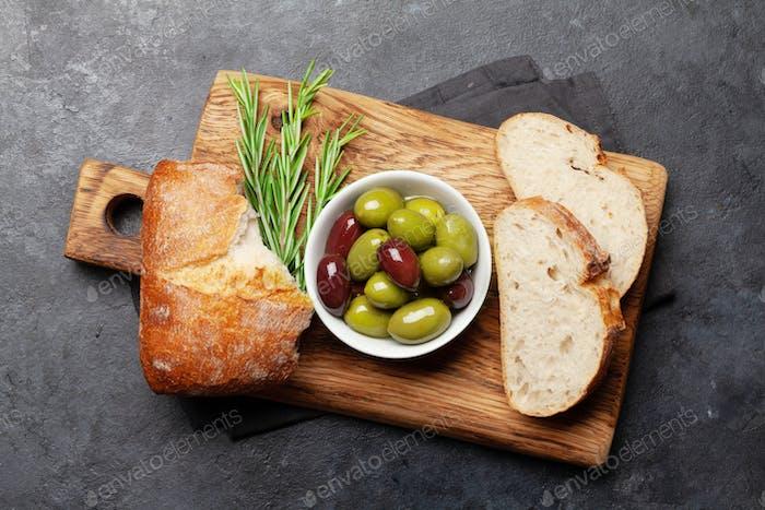 Ripe olives and ciabatta bread