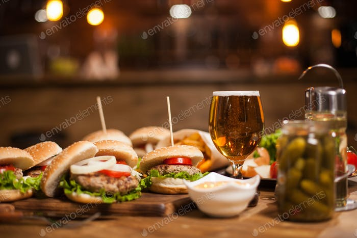 Variety of burgers on a restaurant wooden table