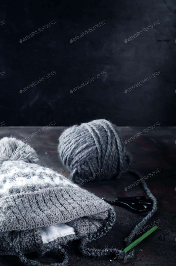 Knitted baby cap.