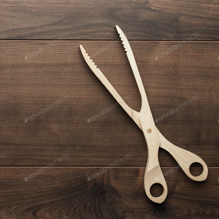 Wooden Grill Tongs On The Table