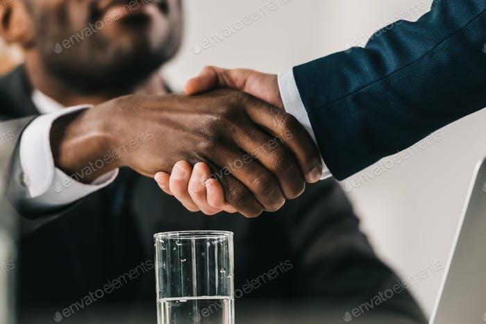 cropped shot of african-american businessmen shaking hand