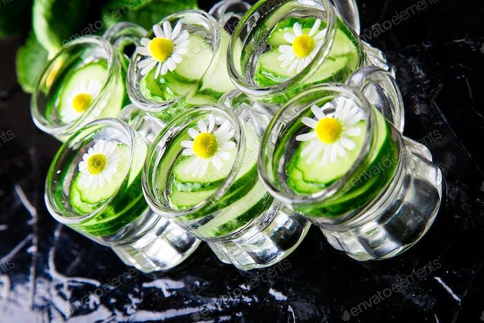 Cucumber water in six little mason glass