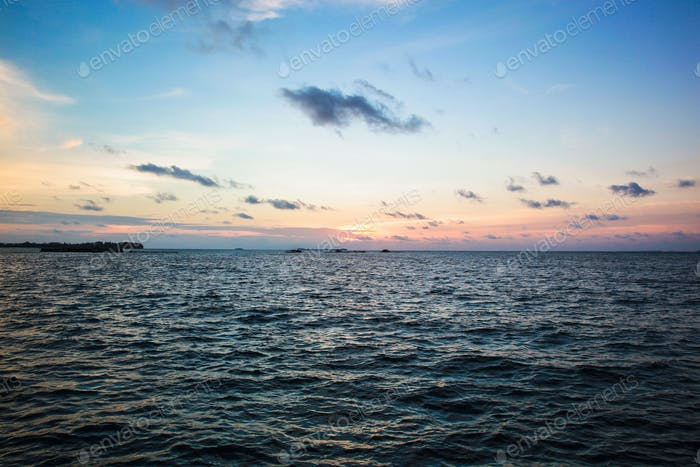 Ocean background with sunset sky