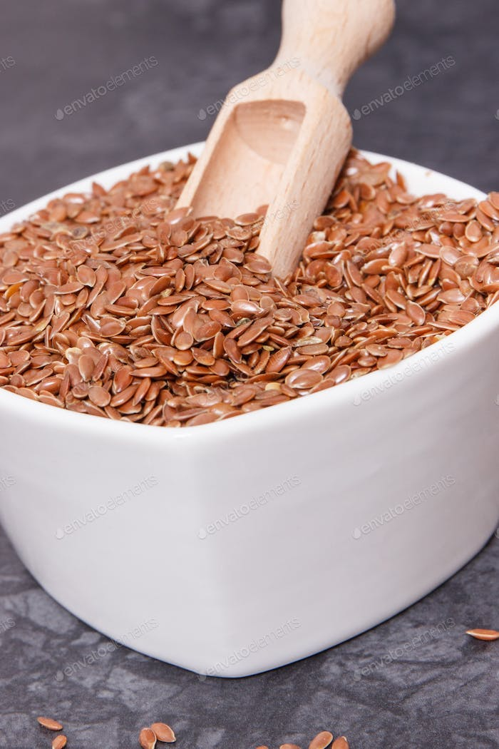 Linseed in glass bowls as healthy food containing vitamins, fiber and acids omega