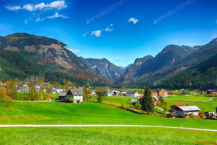 Alpine green fields and traditional wooden houses view of the Go