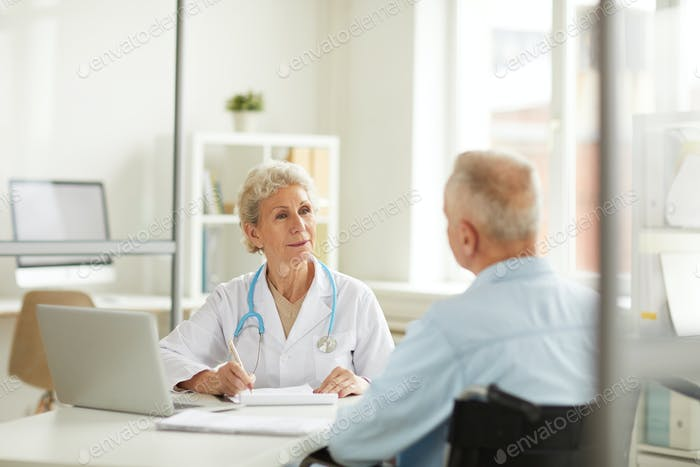 Doctor Consulting Senior Patient