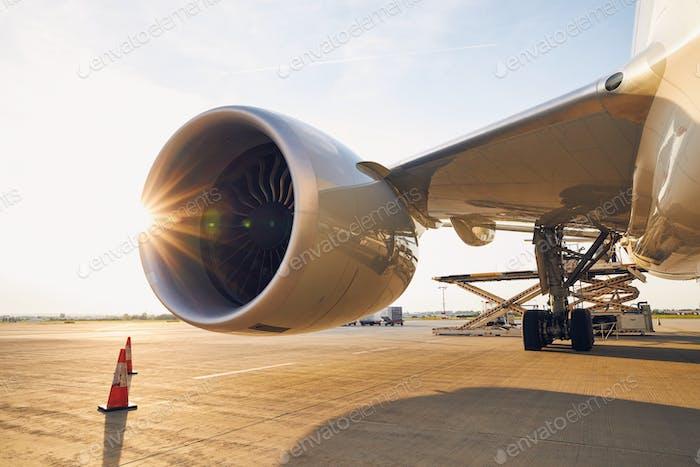 Large jet engine at sunset