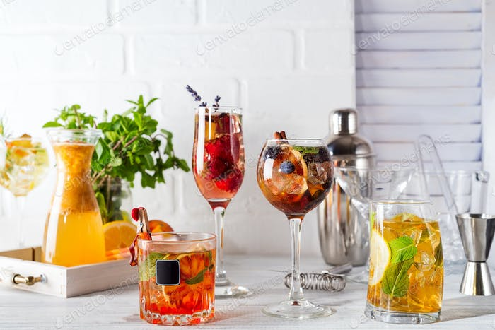 Selection of colorful festive drinks, alcoholic beverages and cocktails in elegant glasses on a