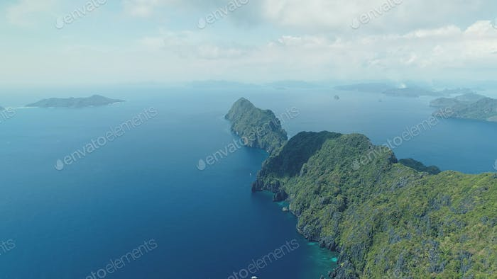 Asia mountainous isle with exotic nature variety scape. Tropical highland island aerial view