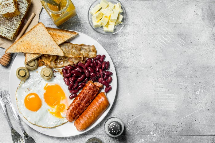 traditional English breakfast. Fried eggs with sausages and fried bread.