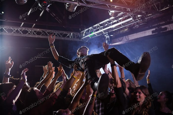 Crowd surfing at a concert