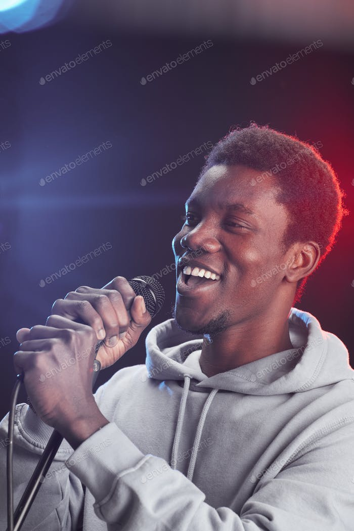 Young African-American Man Singing to Microphone