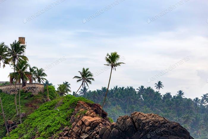 Small lighthouse on tropical coast in Sri Lanka