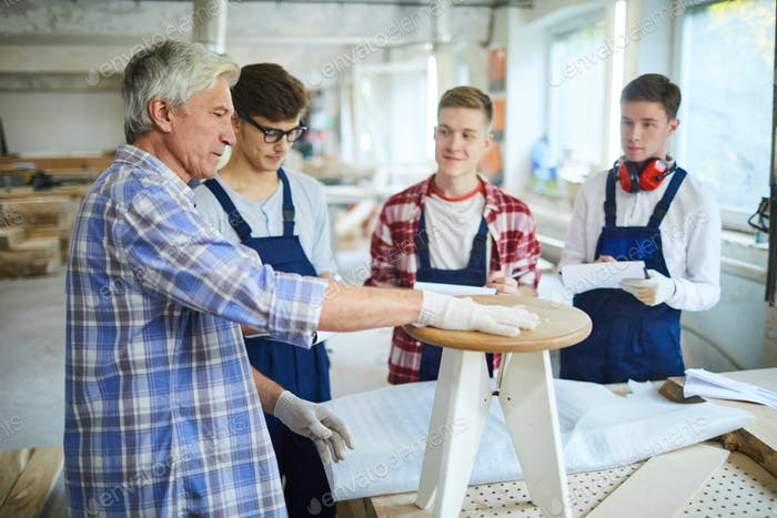 Teaching to make furniture from wood at class