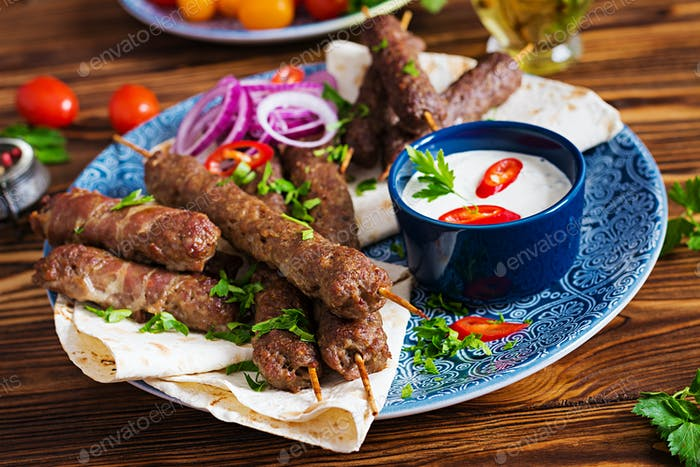 Kebab adana, chicken, lamb and beef on lavash bread