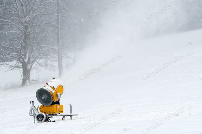 Snow making machine close up. Snow cannon in winter