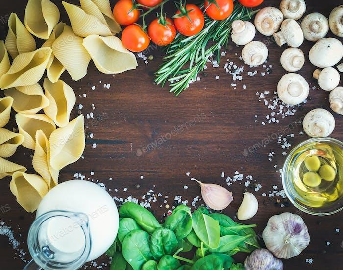 Pasta ingredients: conchiglioni,mushrooms, a jug of cream, olive
