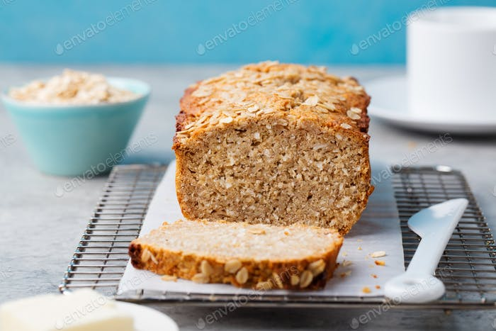 Healthy vegan oat and coconut loaf bread, cake on a cooling rack