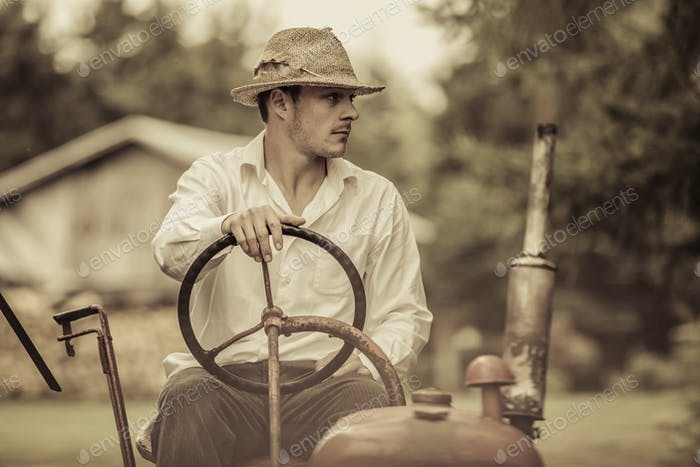 Young Farmer on a Vintage Tractor