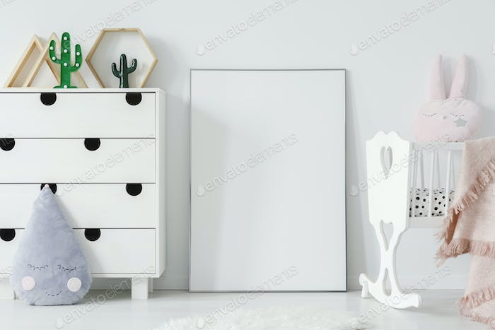 Poster with mockup between white cradle and cabinet in child's r
