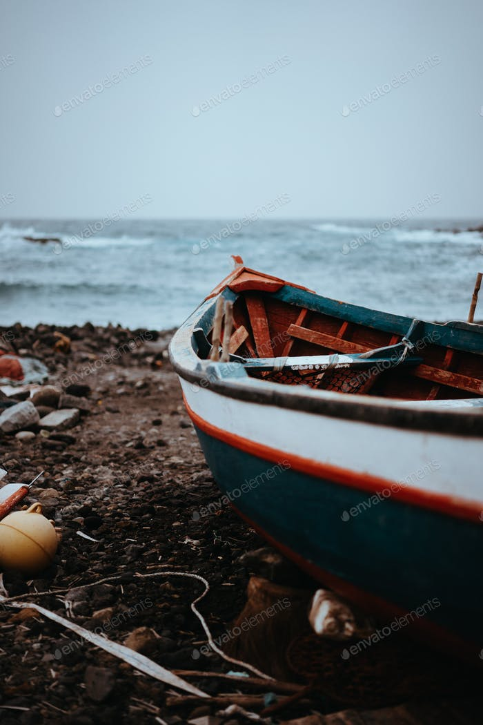 Fishing boat on shore during stormy Atlantic ocean. Sinagoga location on Santo Antao Island. Cape