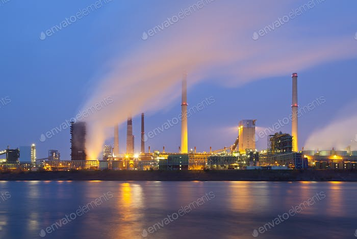 Industry By River At Night