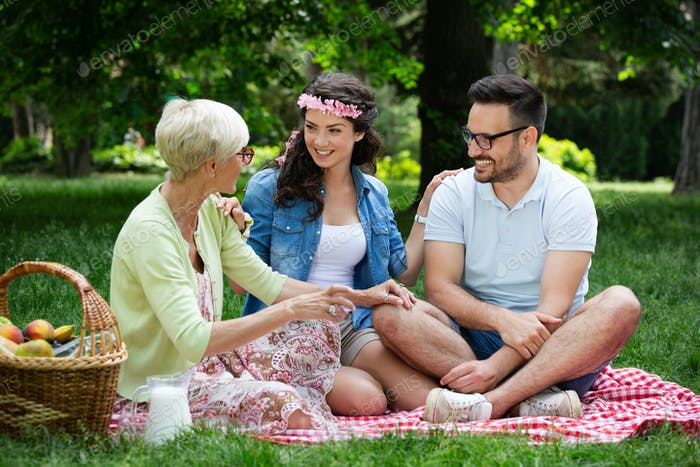 Happy family having picnic in park outdoors