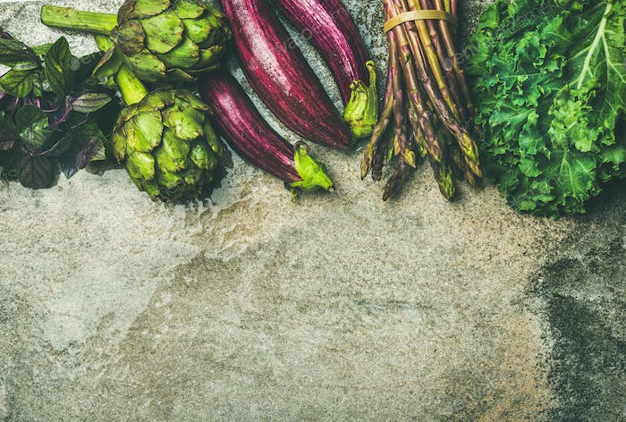 Flat-lay of fresh green and purple vegetables, copy space