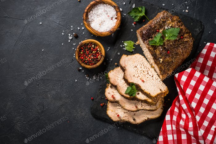 Baked pork meat ham on black kitchen table