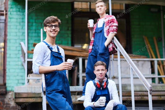 Cheerful handsome guys in workwear