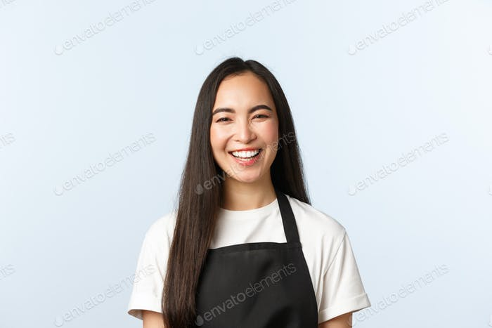 Coffee shop, small business and startup concept. Carefree smiling, cheerful asian female smiling and