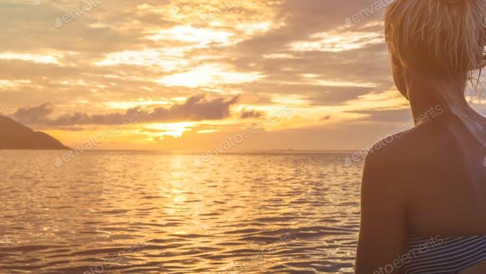 Silhouette of Jung Women in Warm Sunset Light, Kri Island. Raja Ampat, Indonesia, West Papua