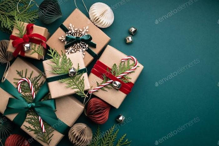 Many Christmas Gift Boxes on Turquoise Background.